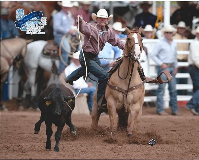 Logan Harkey roping a calf