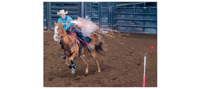 Ethan Wilkinson riding in cowboy mounted shooting competition