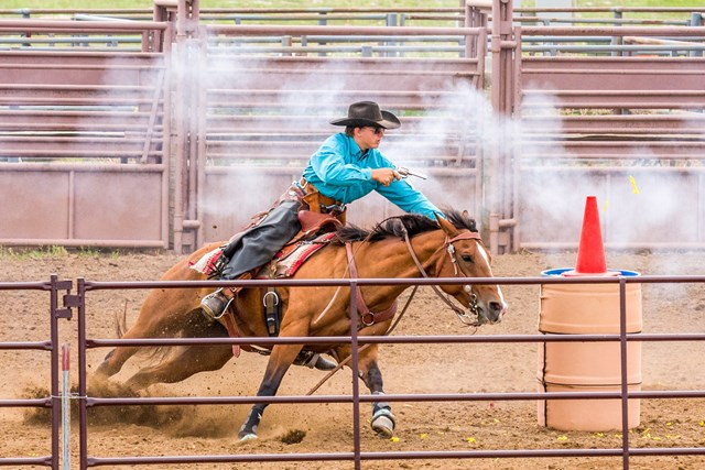Ethan Wilkinson on horseback competing in cowboy mounted shooting
