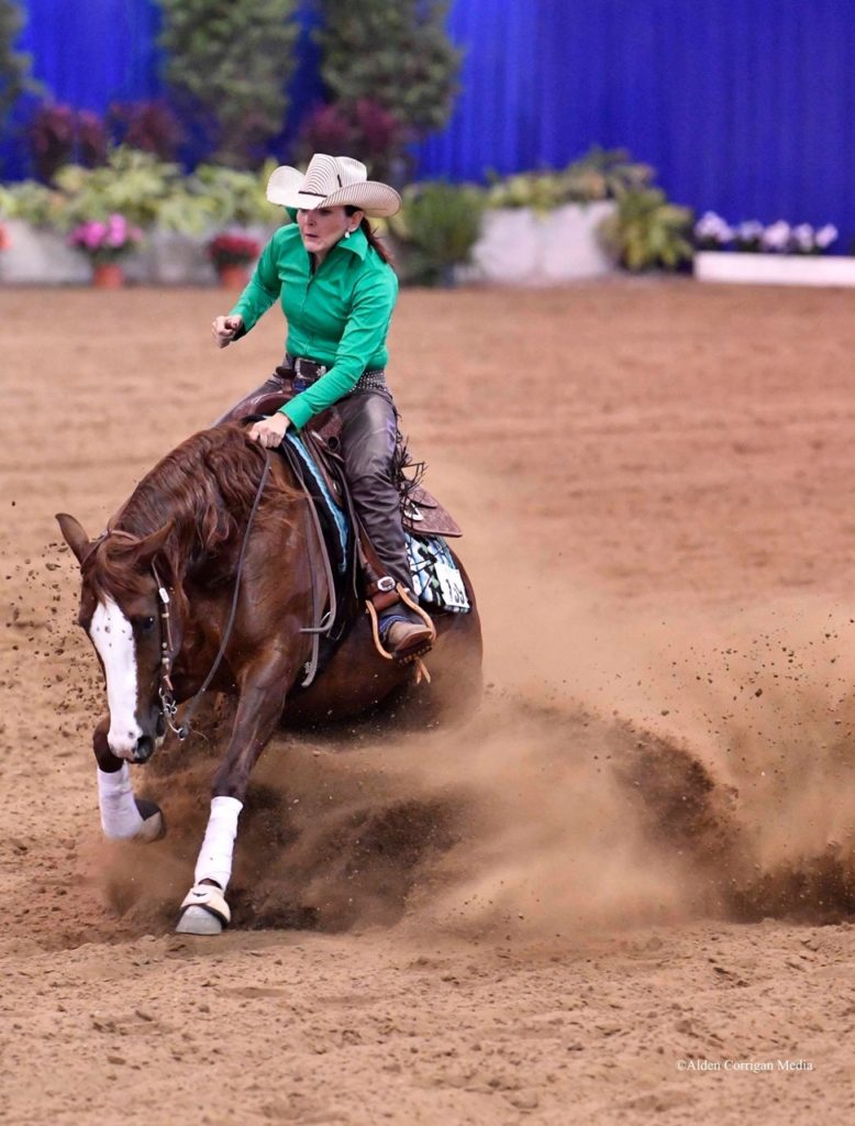 Heather Thompson performs at reining event