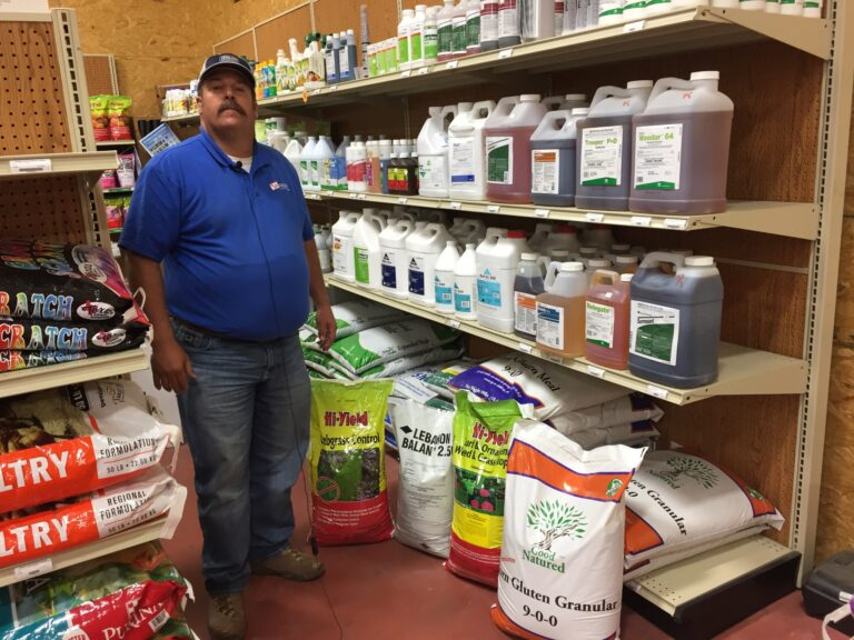 Cody stands next to shelves of products